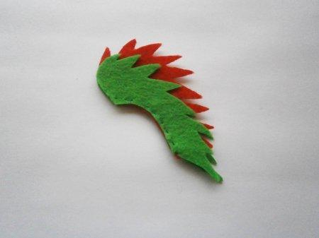 Емблемата от филц на коледната елха